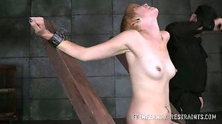 Slim blonde bitch bounded with cuffs gets her pussy toyed
