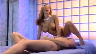 Sensational classic blonde milf on the bed rides on a dick
