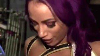 Sasha Banks touch her boobs