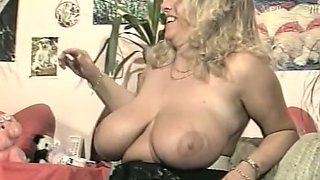 Mature and voluptuous blonde woman flashes her huge jugs