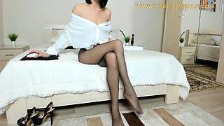 Elegant legs of a slim lady in nylon pantyhose