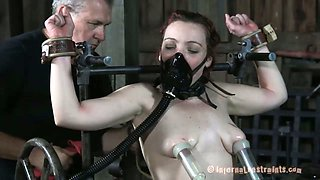 Bounded redhead girl gets her pussy drilled with big toys