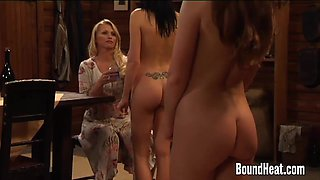 Lesbian Mistress Massaging Slave Bodies With Oil