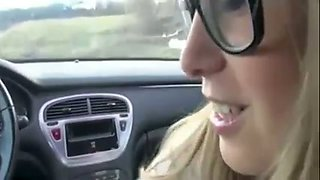 Sexy blonde hussy in glasses gives me some really fantastic blowjob in car