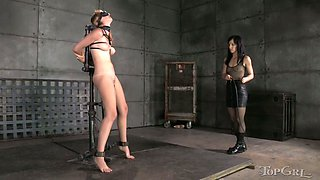 She stands in the room all tied up while her GF caresses her sexy naked body
