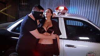 A cop fucks a sexy, busty babe on the hood of his patrol car
