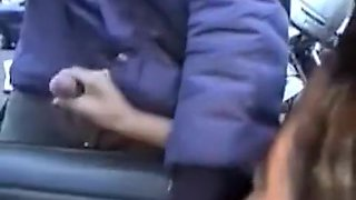 Dogging girl gives handjobs out the car window