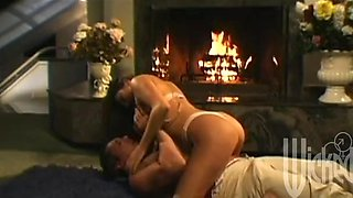 Babe with massive tits fucked doggystyle by the fireplace