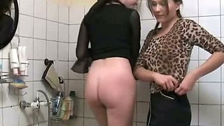 Evgenia and Olga pee in the bathroom and wash their cunts