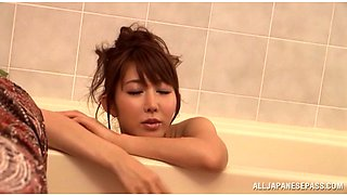 Japanese babe gets big tits oiled massaged then handles two cocks