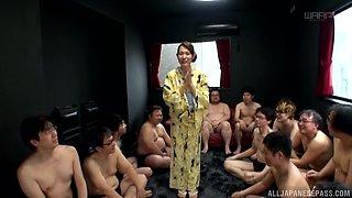Imai Mayumi enjoys a gangbang before being covered in semen