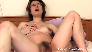 Mature with glasses fills up her love tunnels
