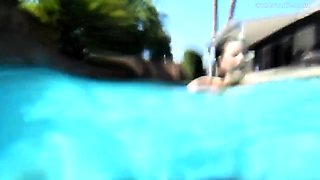 Exciting brunette with big hooters fucks herself in the pool