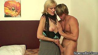 Old grandma in pantyhoses rides his big cock