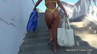 Milf in yellow swimsuit