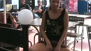 Blonde hot teen in pulls up her skirt and flashes her pussy in the cafe