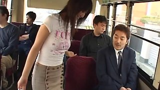 Japanese babe giving a handjob to a businessman on a bus ride