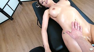 Femme fatale Cherie Deville gets her body oiled up before a crazy sex with masseur