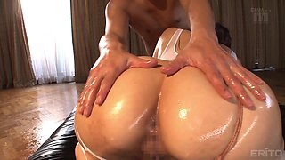 Oiled babe Shiori Kamisaki makes a big cock disappear in her pussy