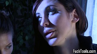 Toyed lesbian drilled with machine in duo