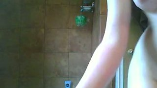 Sizzling girl drills her pussy with a dildo in the bathroom