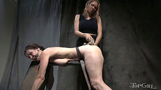 Abused girl bent over and strapon fucked by mistress