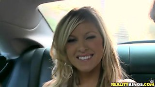 Slutty blonde gives a blowjob in a car before she gets smashed.