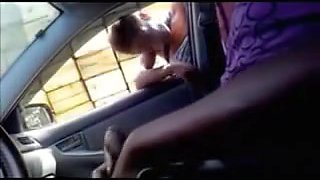Girl looks into the car and notices hard dick flashing