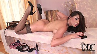 Glamorous lingerie girl takes dildo machine