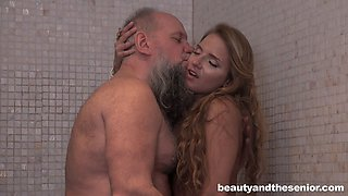 Older seasoned bearded hunk gives his load to young brunette