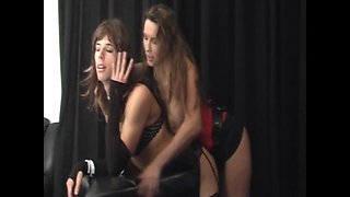 Strapon Jane fucks big cock TGirl slut Lisa over her bench before she cums all over her big tits