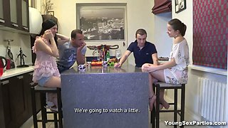 Two lewd teens show their blowjob and cock-riding skills in a foursome