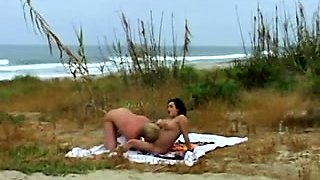Buxom babe gets her pussy licked and fucked on the beach