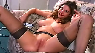Gorgeous brunette shows her shaved snatch while smoking