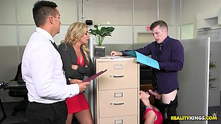 ryan smiles sucks her boss's dick while his is talking with coworkers