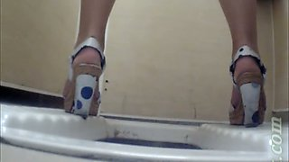 Fine white stranger girl in high heel shoes filmed pissing in the toilet