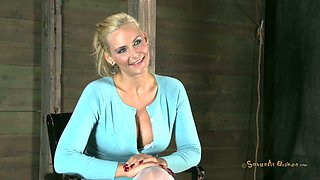 Flexible buxom tied up slave Phoenix Marie gives a deepthroat