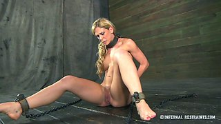 Shapely blonde is chained in the dungeon for punishment