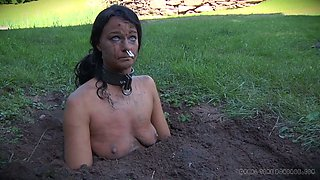 Filthy and dirty slut is made to toss in the ground naked
