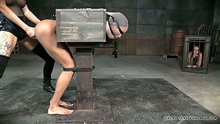 Ebony slave girl bounded with wooden box gets her ass hole drilled