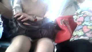 Voyeur amateur vid of cute slim Asian chick's upskirt in the public bus