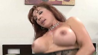 Brown haired brunette in stockings hops on meaty pole and rubs her clit