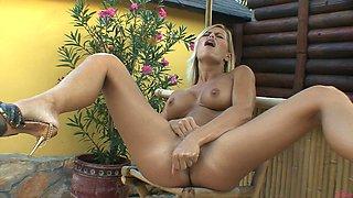 Hot blonde Gitta Szoke puts that dildo in her shaved pussy