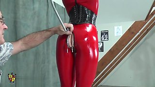 rubber bondage doll ass hooked and put in bondage