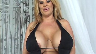 Chubby cougar with big fake tits enjoying a hardcore cowgirl style fuck