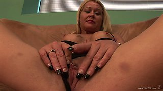 Amateur blond milf wearing a bra and thong fingers her cunt