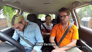 tattooed guy bangs babe in driving school car