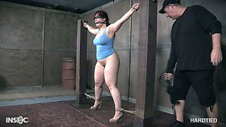 Chubby busty and big bottomed chick Tegan Trex gets punished in the BDSM room