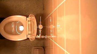 Hidden camera in the public toilet ceiling