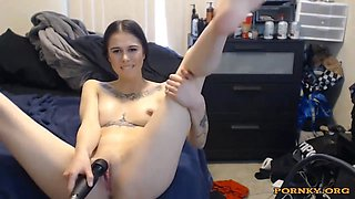 Stunning emo girl using a huge dildo to masturbate and tease naked on a webcam